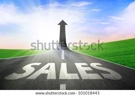 A road turning into an arrow rising upward symbolizing growth and improvement of sales