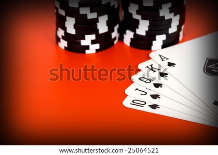 a royal flush poker hand set with chips