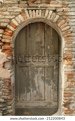 a rustic old wooden door in an ancient building