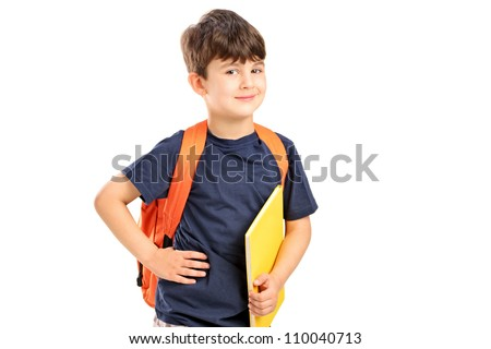 A school boy with backpack holding a notebook isolated against white background