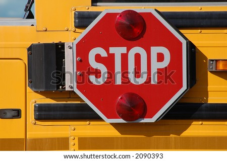 A school bus stop sign