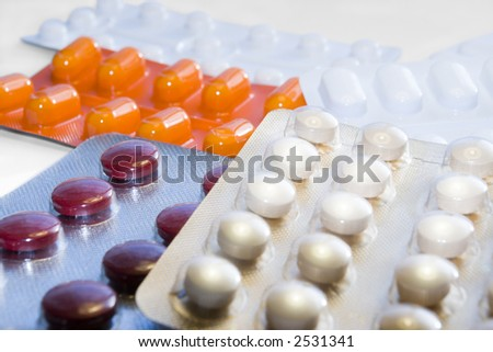 A selection of pills in shiny wrappers