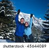 A senior couple in a winter setting in the alpine mountains. Active and happy seniors. - stock photo