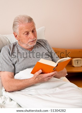 a senior in the nursing home to read the book in bed