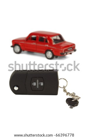 A set of car keys on the background of a model car