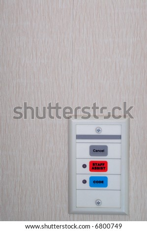 A set of hospital emergency code call buttons.