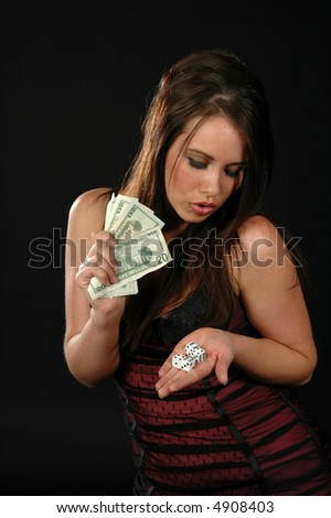 A sexy woman about to place a bet on a game of chance