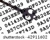 A sheet with encrypted data with a shadow of old-fashioned key - stock photo