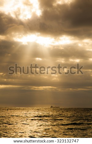 A ship in silent sea with the sunlight in the evening