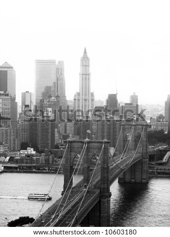 A shot of the Brooklyn bridge in New York City - black and white.