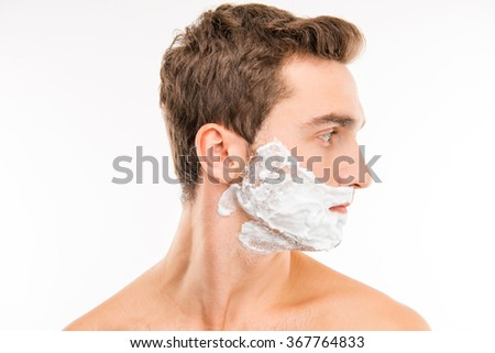 A side-view portrait of young man with shaving foam