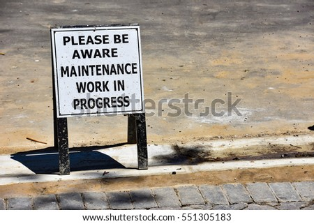 A sign in  Plettenberg Bay in South Africa alerting please be aware maintenance work in progress