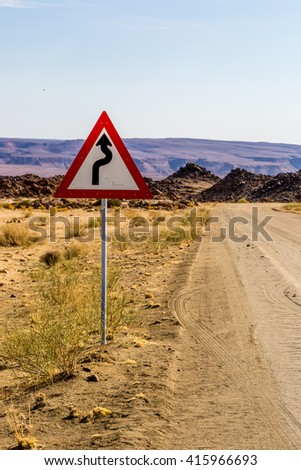 A sign showing turns ahead in the desert of Namibia, Africa.