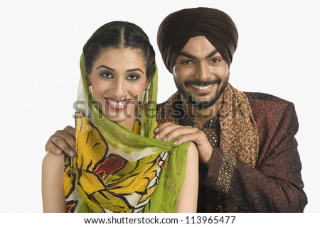 A Sikh couple smiling