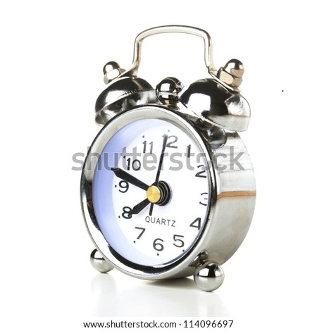 a silver retro alarm bell on white background