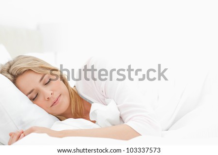 A sleeping woman with her arms stretched slightly out in front of her.