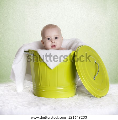 a small baby, in a bucket