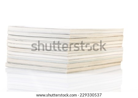 A stack of magazines isolated on a white background