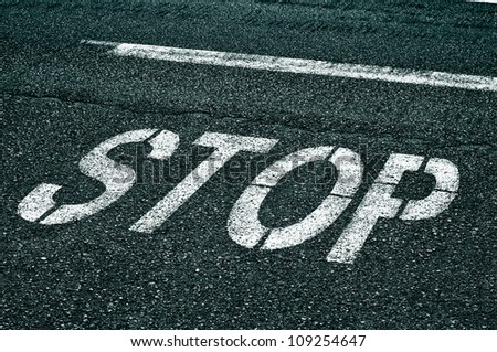 a stop sign painted on the road