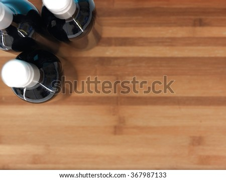 A studio photo of bottled red wine