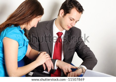a successful business team is looking on their clock