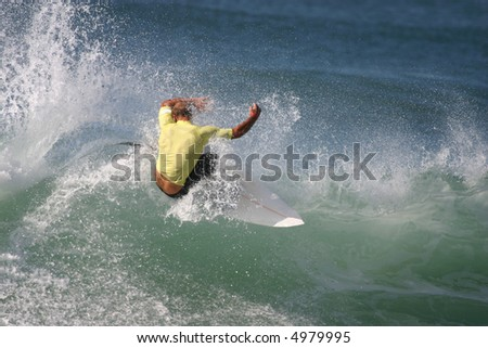 A surfer snaps off the lip sending spray flying.