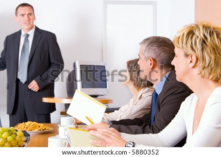 A team discussing in the conference room.