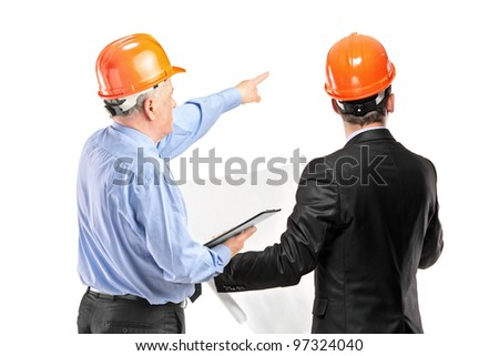 A team of construction workers with orange helmets posing isolated on white background