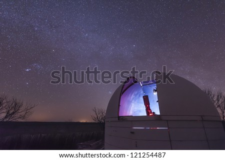 A telescope sits in an open observatory dome at the 3RF Astronomy Campus near Crowell, Texas.