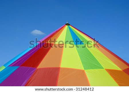 A tent made up of many different color patches