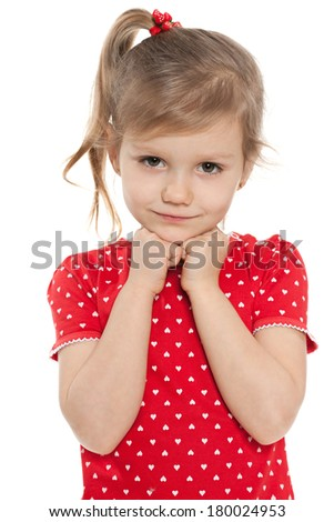 A thoughtful preschool girl on the white background