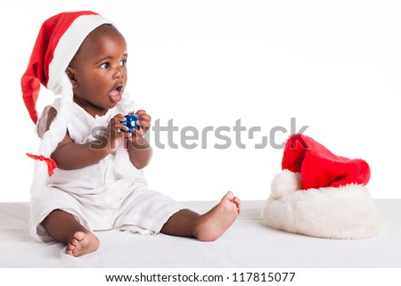 A tiny African baby girl are ready for her first Christmas to arrive.