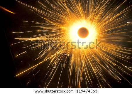 A top view of a type of firework/cracker known as Chakra or Chakri rotating on the ground, during the Diwali festival celebrations in India