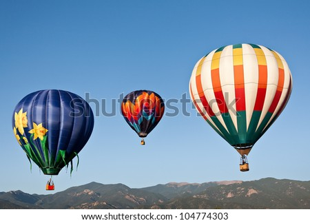 A trio of balloons ascending into the skies above Colorado's front range.