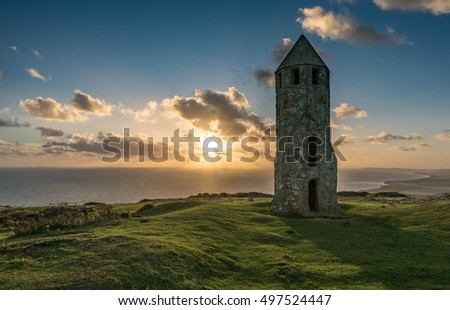 A twelfth Century Lighthouse at Sunset on the Isle of Wight