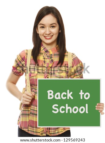 A university student holding a Back To School signboard