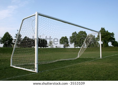 A vacant soccer goal.