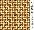 A variation of a houndstooth pattern in red and yellow. - stock photo