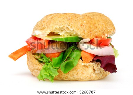 A very healthy brown bun containing lettuce, carrots, tomato, cucumber and onion
