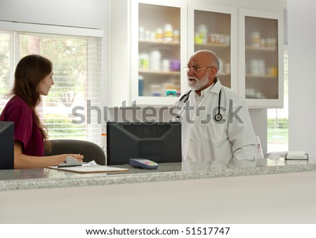 a vet speaks to his assistant