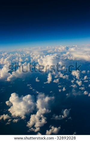 A view of clouds from an airplane window