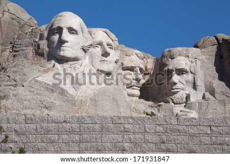 A view of Mount Rushmore under a blue sky.