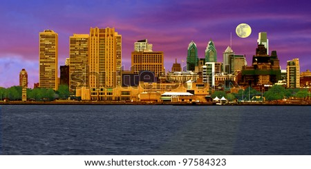 A view of Philadelphia, Pennsylvania's skyline at dusk for a colorful cityscape comprised of various commercial buildings.
