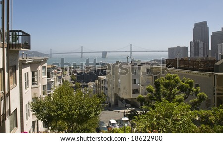 A view of San Francisco streets with the Bay Bridge in the background