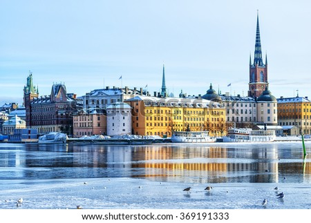 A view of Stockholm's gamla stan region from across the frozen river in winter time.