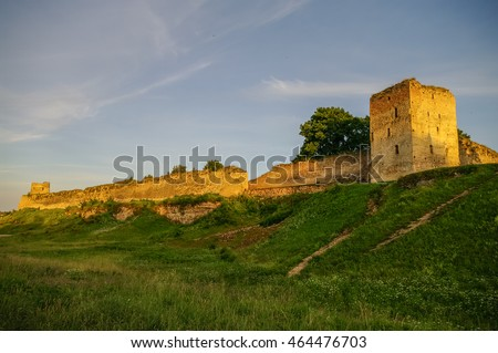 A view of the medieval Izborsk fortress walls and towers in sunset, Pskov region,Russia