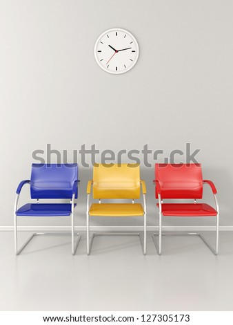 A wall clock and 3 colored chairs in the waiting room