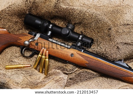 A walnut stocked big-bore hunting rifle intended for use on dangerous game.