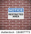 A warning sign indicating Restricted Area  - stock photo