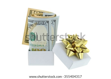 A white box with golden gift ribbon with new rolled United stated bills inside,  isolated on white background